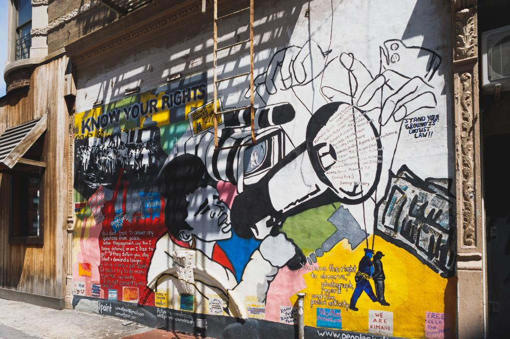 multicolored wall with graffiti photo